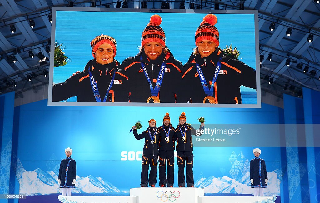 Silver medalist Jan Smeekens of the Netherlands, gold medalist Michel Mulder of the Netherlands and bronze medalist Ronald Mulder of the Netherlands celebrate on the podium during the medal ceremony for the for the Men's 500m Speed Skating on day 4 of the Sochi 2014 Winter Olympics at Medals Plaza on February 11, 2014 in Sochi, Russia.
