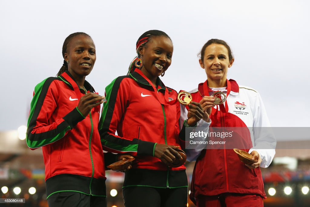 Silver medalist Janet Kisa of Kenya, gold medalist Mercy Cherono of Kenya and bronze medalist Jo Pavey of England pose on the podium during the medal ceremony for the Women's 5000 metres at Hampden Park during day ten of the Glasgow 2014 Commonwealth Games on August 2, 2014 in Glasgow, United Kingdom.