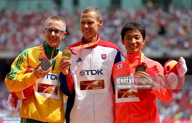 Silver medalist Jared Tallent of Australia gold medalist Matej Toth of Slovakia and bronze medalist Takayuki Tanii of Japan pose on the podium during...