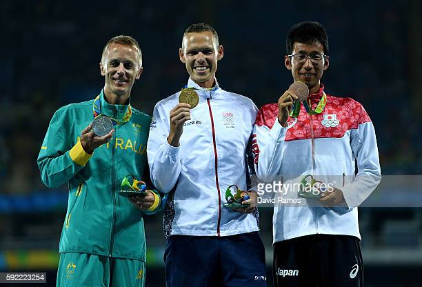Silver medalist Jared Tallent of Australia gold medalist Matej Toth of Slovakia and bronze medalist Hirooki Arai of Japan pose on the podium during...