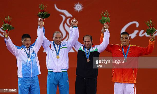 Silver medalist Jargalsaikhan Jargalsaikhan of Mongolia gold medalist Artur Taymazov of Uzbekistan bronze medalists Fardin Masoumi Valadi of Iran and...