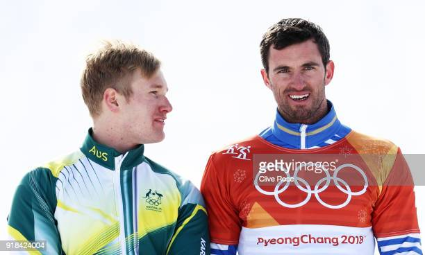 Silver medalist Jarryd Hughes of Australia and gold medalist Pierre Vaultier of France pose during the victory ceremony for the Men's Snowboard Cross...