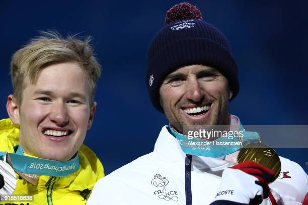Silver medalist Jarryd Hughes of Australia and gold medalist Pierre Vaultier of France celebrate during the medal ceremony for Men's Snowboard Cross...