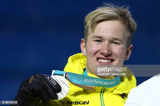 Silver medalist Jarryd Hughes of Australia celebrates during the medal ceremony for Men's Snowboard Cross Finals on day six of the PyeongChang 2018...