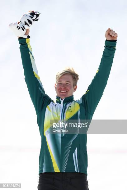 Silver medalist Jarryd Hughes of Australia poses during the victory ceremony for the Men's Snowboard Cross Big Final on day six of the PyeongChang...