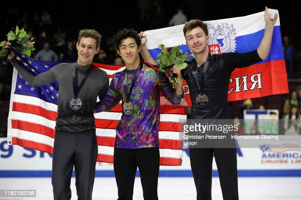 Silver medalist Jason Brown of the United States, gold medalist Nathan Chen of the United States and bronze medalist Dmitri Aliev of Russia pose...