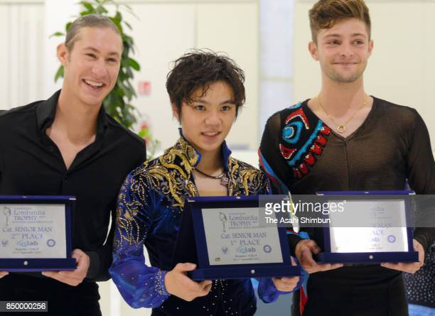 Silver medalist Jason Brown of the United States gold medalist Shoma Uno of Japan and Brendan Kerry of Australia pose on the podium at the medal...