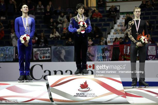 Silver medalist Jason Brown of USA gold medalist Shoma Uno of Japan and bronze medalist Alexander Samarin of Russia in the victory ceremony for men...