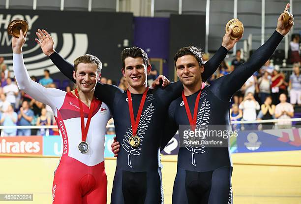Silver medalist Jason Kenny of England, gold medalist Sam Webster of New Zealand and bronze medalist Edward Dawkins of New Zealand pose on the podium...
