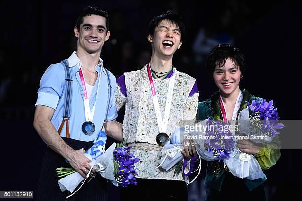 Silver medalist Javier Fernandez of Spain, Gold medalist Yuzuru Hanyu of Japan and Bronze medalist Shoma Uno of Japan pose during the Men final...
