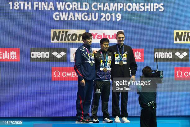 Silver medalist Jay Litherland of the United States gold medalist Daiya Seto of Japan and bronze medalist Lewis Clareburt of New Zealand pose on the...