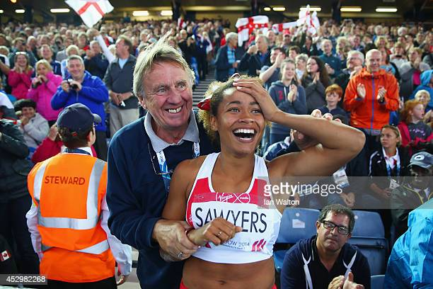 Silver medalist Jazmin Sawyers of England is congratulated by a coach after the Women's Long Jump final at Hampden Park during day eight of the...