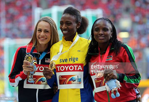 silver medalist Jennifer Simpson of the United States gold medalist Abeba Aregawi of Sweden and bronze medalist Hellen Onsando Obiri of Kenya pose on...