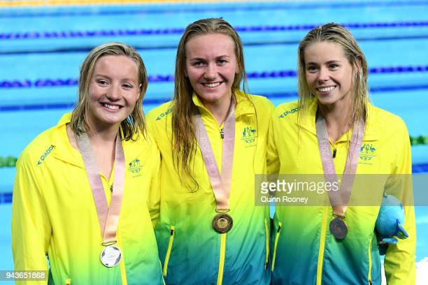 Silver medalist Jessica Ashwood of Australia gold medalist Ariarne Titmus and bronze medalist Kiah Melverton pose during the medal ceremony for the...