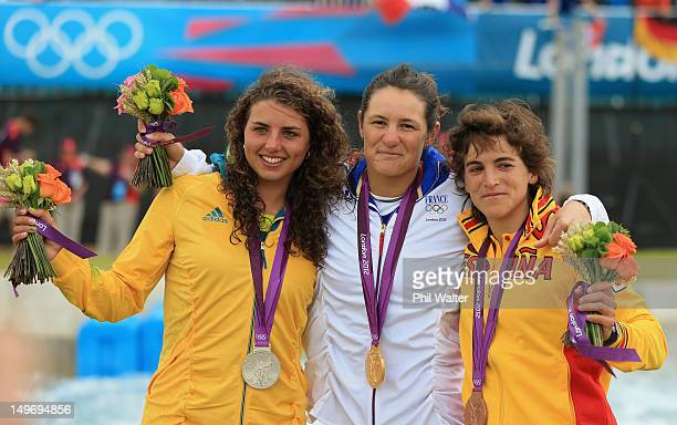 Silver medalist Jessica Fox of Australia gold medalist Emile Fer of France and bronze medalist Maialen Chourraut of Spain celebrate following the...