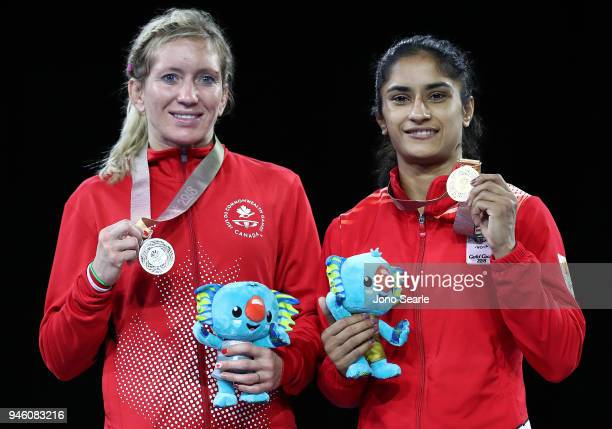 Silver Medalist Jessica MacDonald from Canada and gold medalist Vinesh Vinesh of India pose during the medal ceremony for the women's freestyle 50kg...