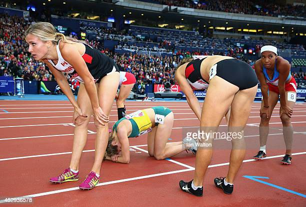 Silver medalist Jessica Zelinka of Canada and gold medalist Brianne Theisen-Eaton of Canada rest after the Women's Heptathlon 800 metres at Hampden...