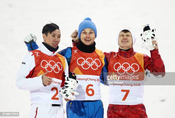 Silver medalist Jia Zongyang of China gold medalist Oleksandr Abramenko of the Ukraine and bronze medalist Ilia Burov of Olympic Athlete from Russia...