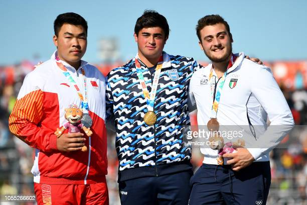 Silver medalist Jialiang Xing of China Nazareno Sasia of Argentina and Carmelo Alessandro Musci of Italy pose in the podium after Men's Shot Put 5kg...