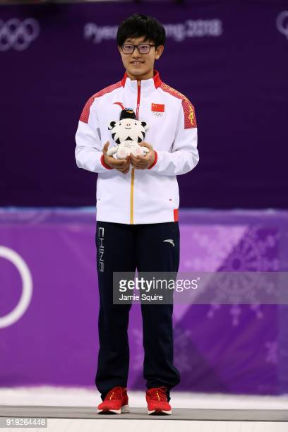 Silver medalist Jinyu Li of China celebrates during the victory ceremony after the Short Track Speed Skating Ladies' 1500m Final A on day eight of...