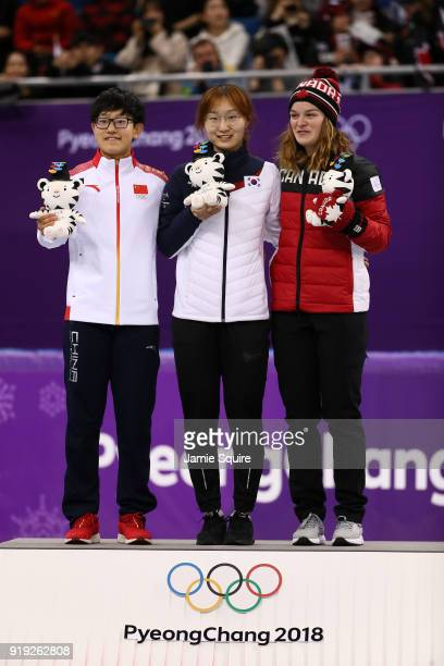 Silver medalist Jinyu Li of China gold medalist Minjeong Choi of Korea and bronze medalist Kim Boutin of Canada celebrate during the victory ceremony...