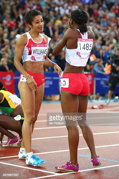 Silver medalist Jodie Williams of England looks to the score board as Bronze medalist Bianca Williams of England rests after the Women's 200m Final...