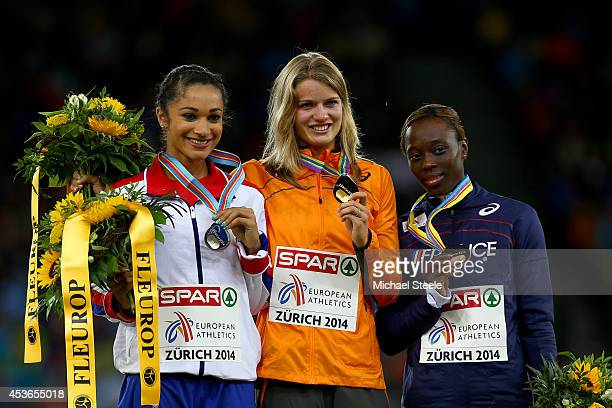 Silver medalist Jodie Williams of Great Britain and Northern Ireland, gold medalist Dafne Schippers of the Netherlands and bronze medalist Myriam...