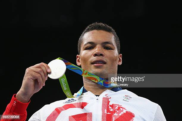 Silver medalist Joe Joyce of Great Britain poses on the podium during the medal ceremony for the Men's Boxing Super Heavy on Day 16 of the Rio 2016...