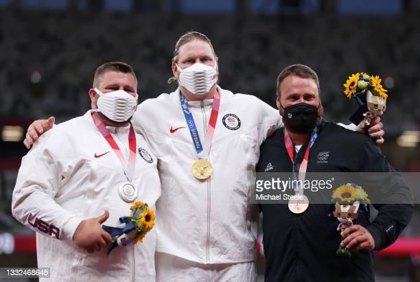 Silver medalist Joe Kovacs of Team United States, gold medalist Ryan Crouser of Team United States and bronze medalist Tom Walsh of Team New Zealand...