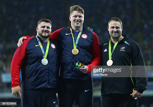 Silver medalist, Joe Kovacs of the United States, gold medalist, Ryan Crouser of the United States, and bronze medalist, Tomas Walsh of New Zealand,...