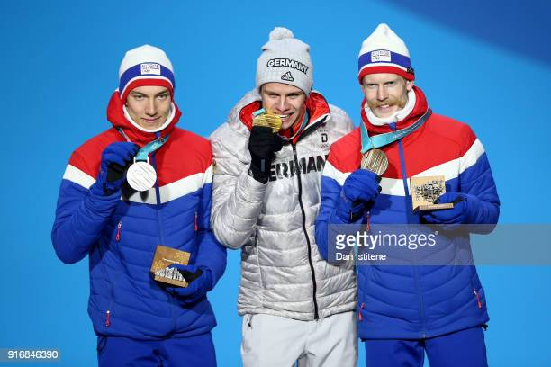 Silver medalist Johann Andre Forfang of Norway gold medalist Andreas Wellinger of Germany and bronze medalist Robert Johansson of Norway pose on the...