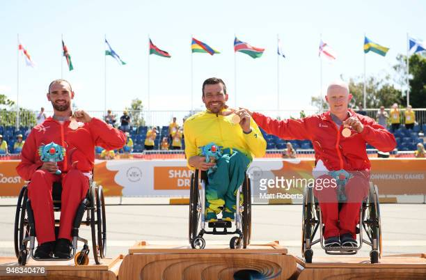 Silver medalist John Smith of England gold medalist Kurt Fearnley of Australia and bronze medalist Simon Lawson of England pose during the medal...