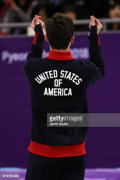 Silver medalist JohnHenry Krueger of the United States celebrates during the victory ceremony after the Short Track Speed Skating Men's 1000m Final A...