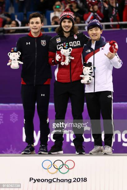 Silver medalist JohnHenry Krueger of the United States gold medalist Samuel Girard of Canada and bronze medalist Yira Seo of Korea celebrate during...
