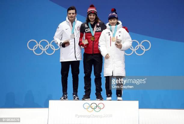 Silver medalist JohnHenry Krueger of the United States gold medalist Samuel Girard of Canada and bronze medalist Yira Seo of Korea celebrate during...