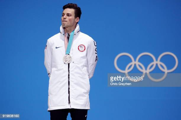 Silver medalist JohnHenry Krueger of the United States stands during the medal ceremony for the Short Track Speed Skating Men's 1000m on day nine of...