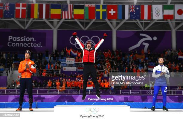 Silver medalist Jorrit Bergsma of the Netherlands, gold medalist Ted-Jan Bloemen of Canada and bronze medalist Nicola Tumolero of Italy celebrate...