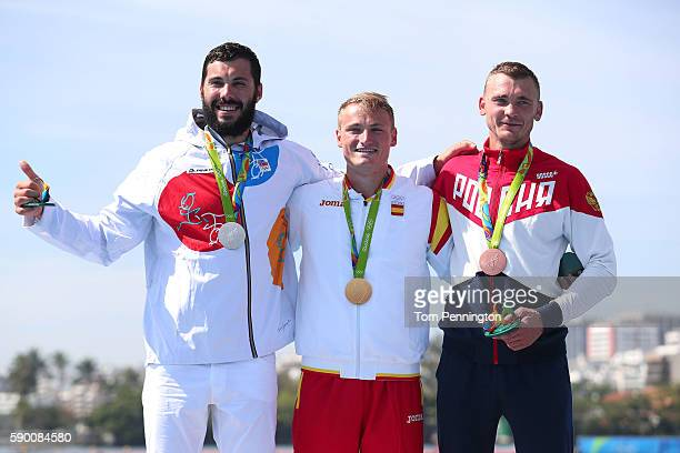 R] Silver medalist Josef Dostal of the Czech Republic gold medalist Marcus Walz of Spain and bronze medalist Roman Anoshkin of Russia celebrate...