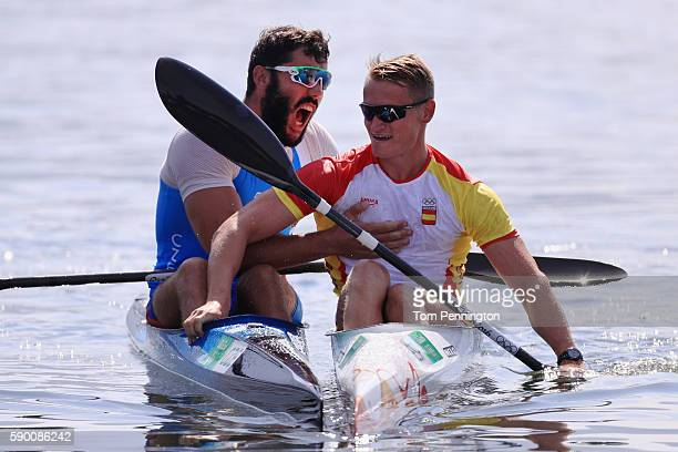 R] Silver medalist Josef Dostal of the Czech Republic gold medalist Marcus Walz of Spain celebrate after the Men's Kayak Single 1000m Final A on Day...