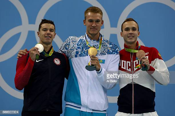 Silver medalist Josh Prenot of the United States gold medalist Dmitriy Balandin of Kazakhstan and bronze medalist Anton Chupkov of Russia pose on the...