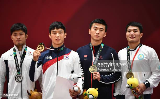 Silver medalist Joshiro Maruyama of Japan gold medalist Baul An of Korea bronze medalists Artur Te of Kyrgyzstan and Yeldos Zhumakanov of Kazakhstan...