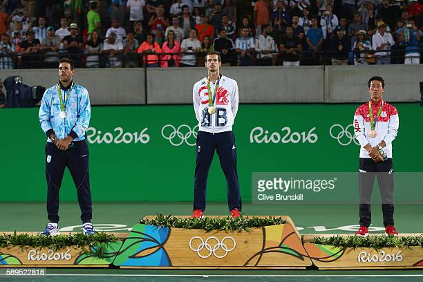 Silver medalist Juan Martin Del Potro of Argentina gold medalist Andy Murray of Great Britain and bronze medalist Kei Nishikori of Japan pose during...