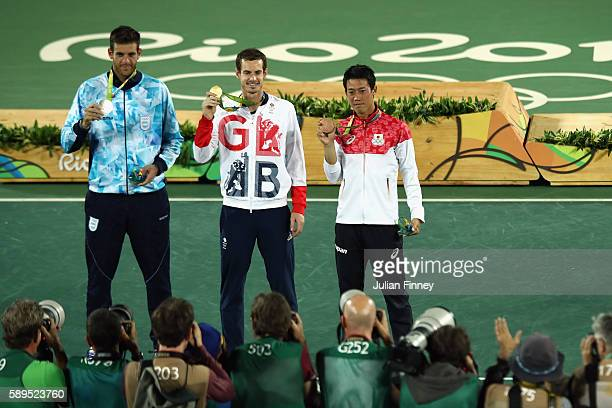 Silver medalist Juan Martin Del Potro of Argentina, gold medalist Andy Murray of Great Britain and bronze medalist Kei Nishikori of Japan pose during...