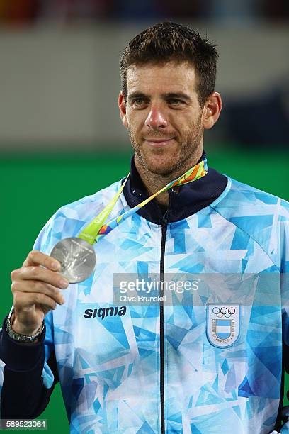 Silver medalist Juan Martin Del Potro of Argentina poses during the medal ceremony for the men's singles on Day 9 of the Rio 2016 Olympic Games at...