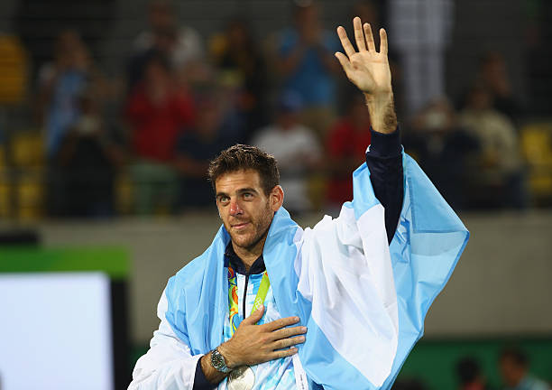 Silver medalist Juan Martin Del Potro of Argentina waves during the medal ceremony for the men's singles on Day 9 of the Rio 2016 Olympic Games at...