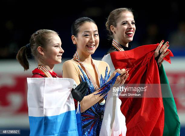Silver medalist Julia Lipnitskaia of Russia gold medalist Mao Asada of Japan and Bronze medalist Carolina Kostner of Italy pose with medal in the...