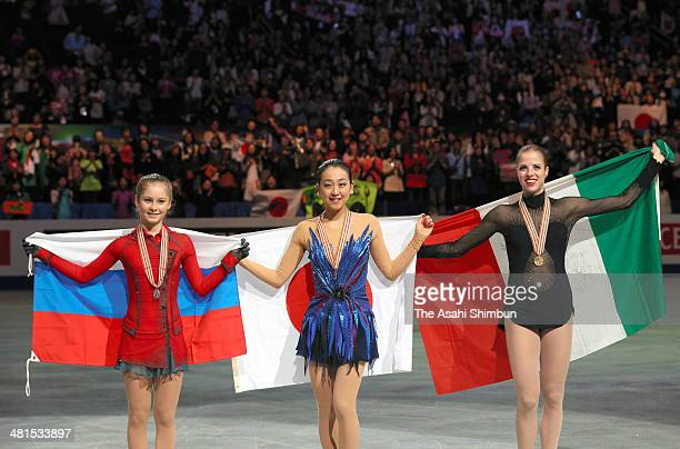 Silver medalist Julia Lipnitskaia of Russia gold medalist Mao Asada of Japan and Bronze medalist Carolina Kostner of Italy pose with medals in the...