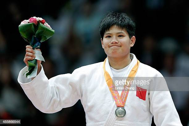 Silver medalist Junxia Yang of China celebrate during the medal ceremony after the Women's 63 kg Final against Dawoon Joung of South Korea at Dowon...