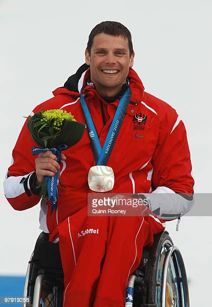 Silver medalist Jurgen Egle of Austria celebrates at the medal ceremony for the Men's Sitting Super Combined during Day 9 of the 2010 Vancouver...