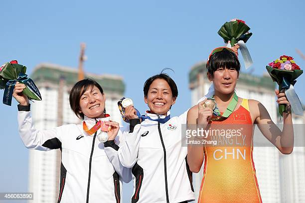 Silver medalist Juri Ide of Japan, Gold medalist Ai Ueda of Japan and Bronze medalists Huang Yuting of China celebrate during the medal ceremony...